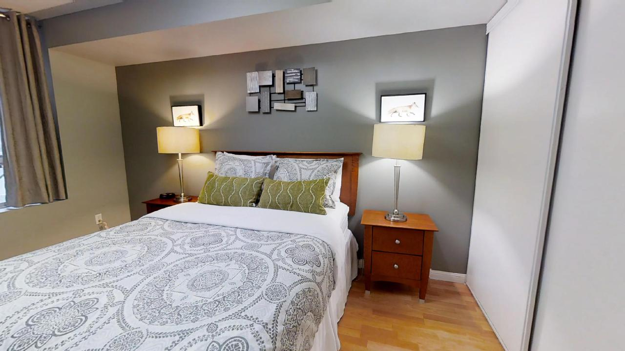 Toronto furnished apartment bedroom at university plaza