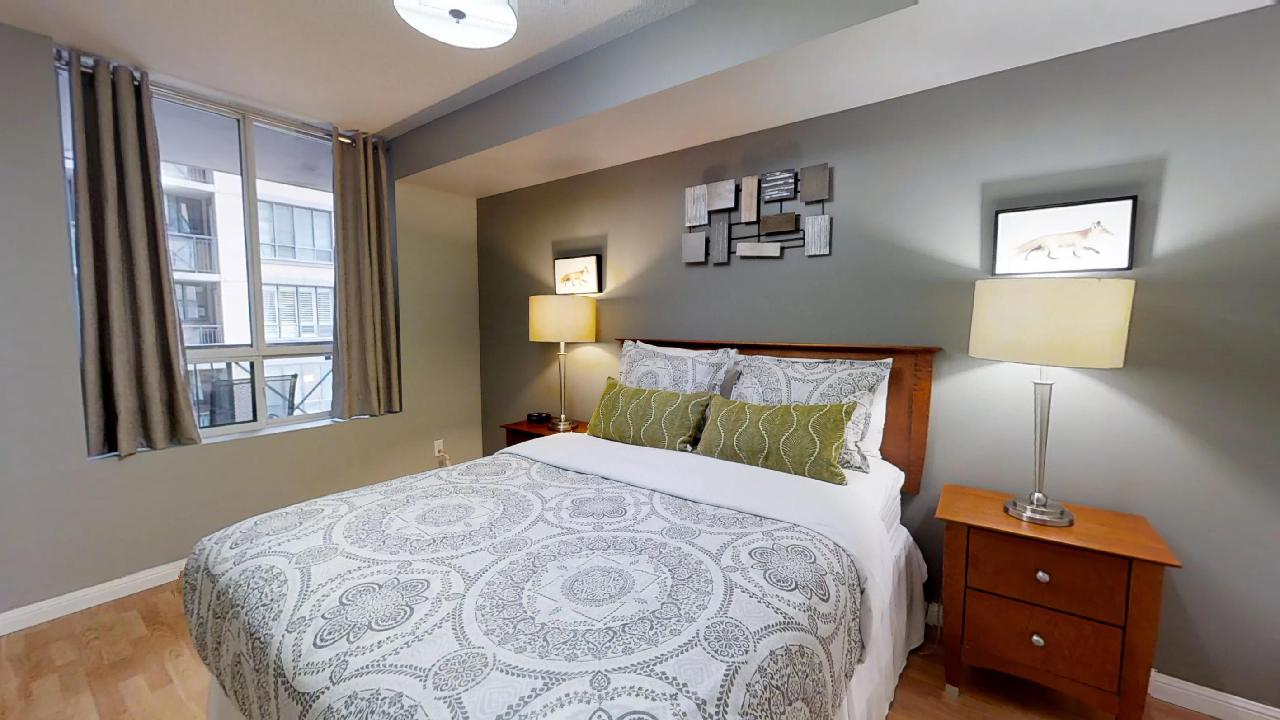 bedroom in toronto furnished apartment at simcoe and adelaide