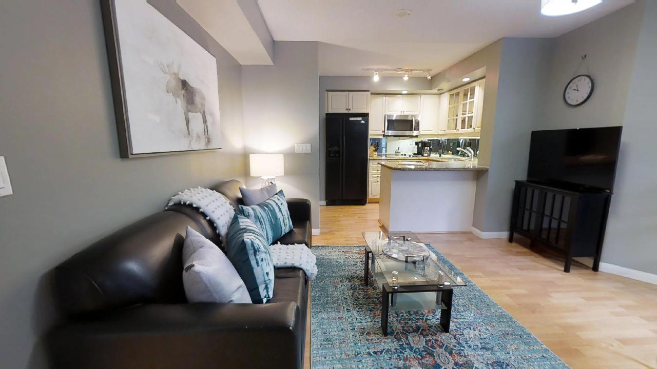 view of living room and kitchen at 140 simcoe condo