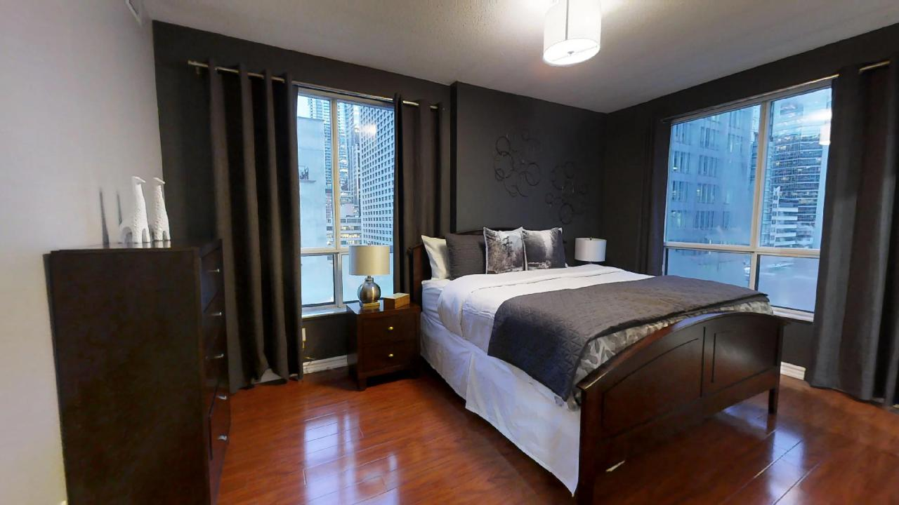bedroom in a furnished apartment located near queen and simcoe, in toronto