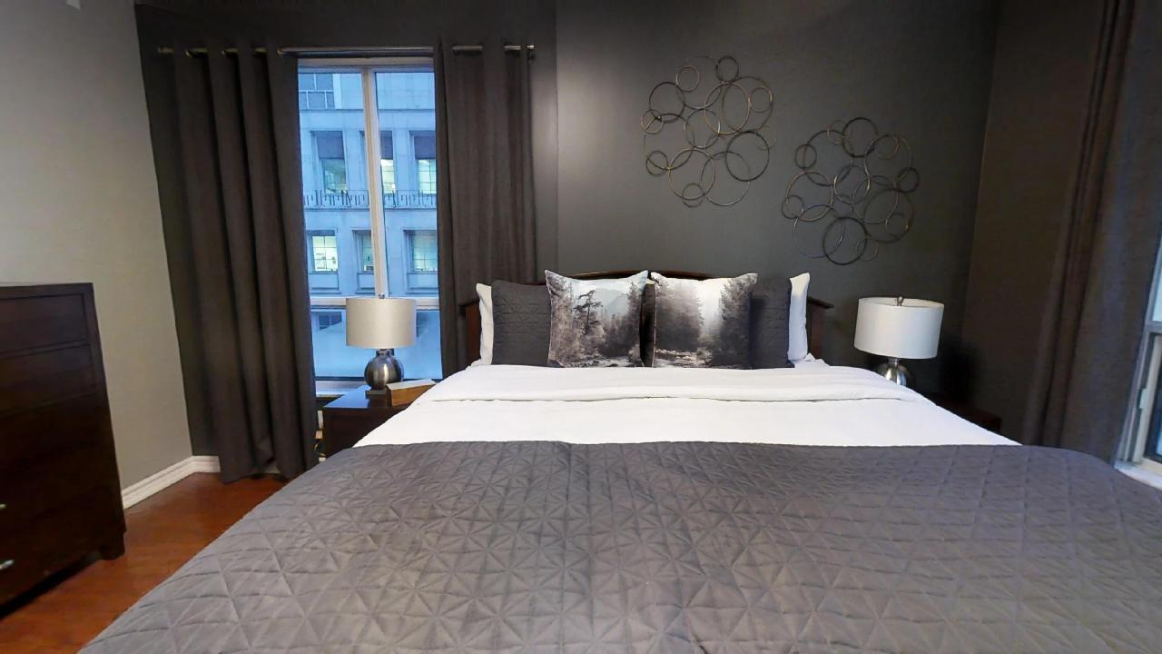 Queen sized bed in a furnished apartment in Toronto, in Qwest condominiums