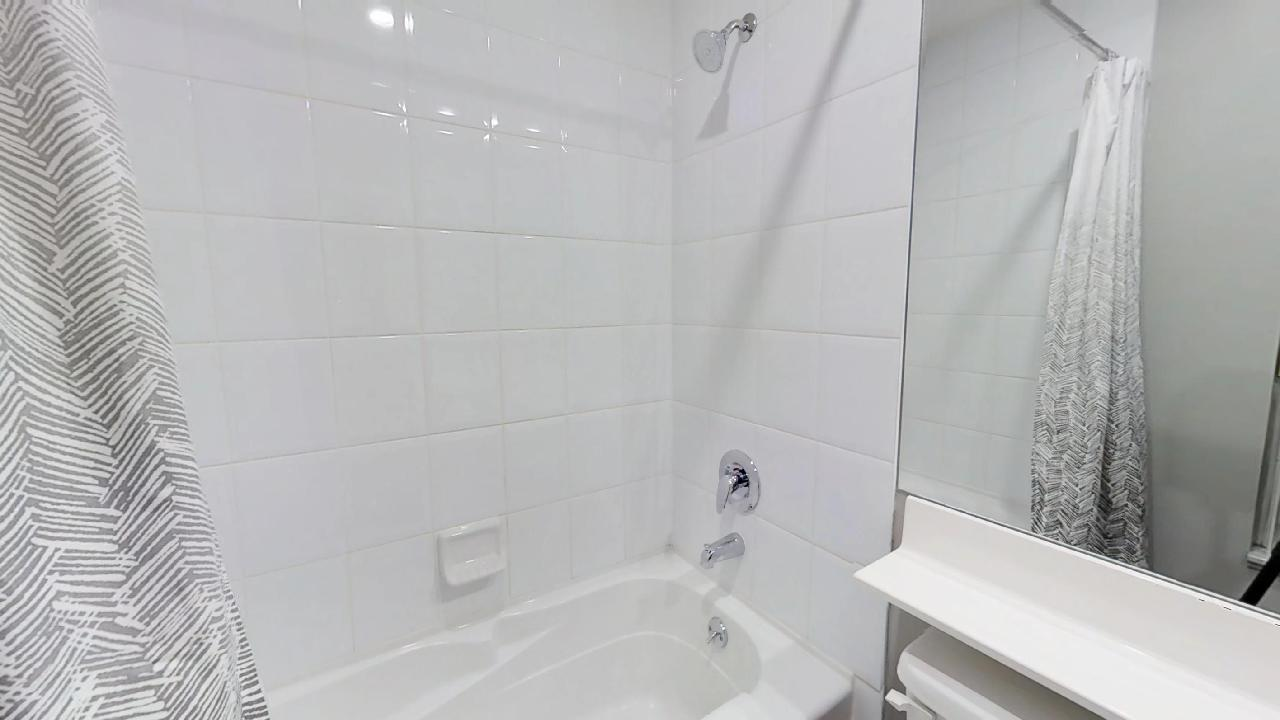 bathroom in a furnished condo near st andrews subway stop in toronto