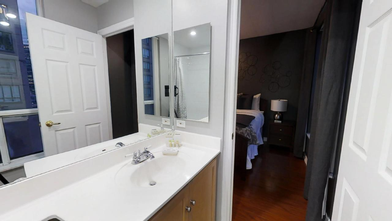 bathroom and bedroom in a furnished apartment near the Financial District, in Toronto