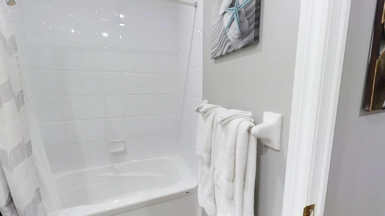 bath towel and shower in a toronto furnished apartment's bathroom, near simcoe and richmond streets