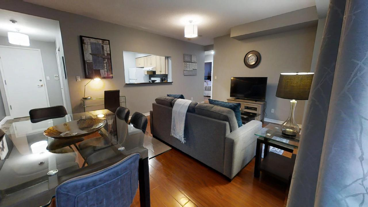 the living room and kitchen in a Qwest two-bedroom furnished apartment, in Toronto