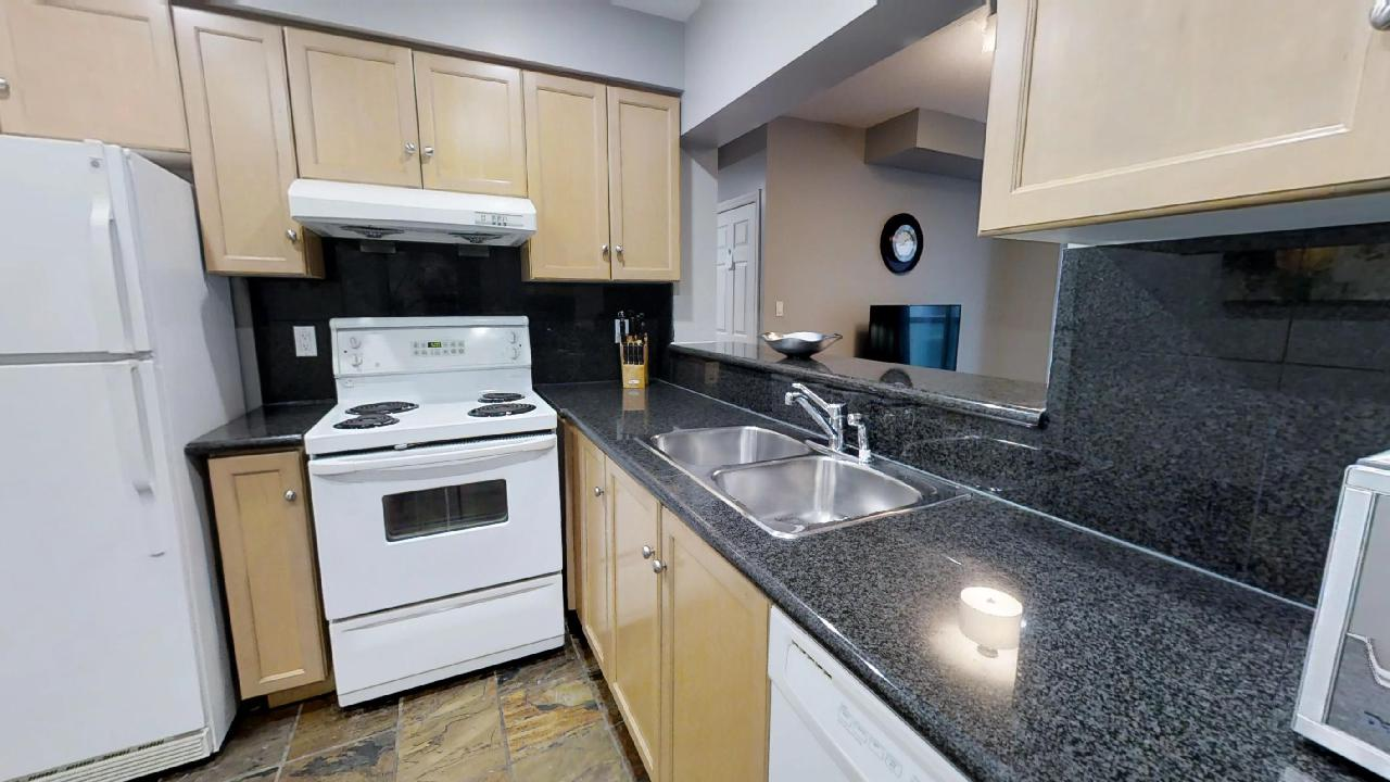 the kitchen of a toronto furnished apartment off of Queen and Simcoe