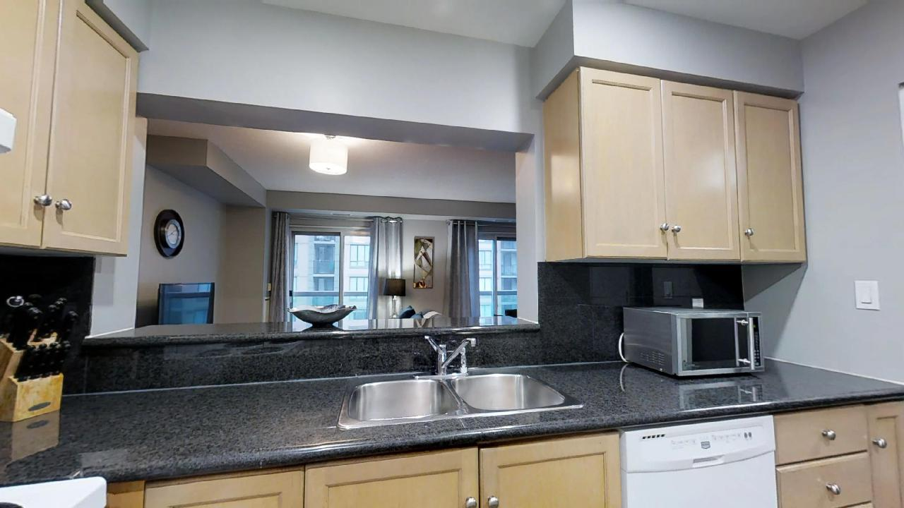 the kitchen window of a Toronto furnished apartment unit located near the Shangri-La Hotel