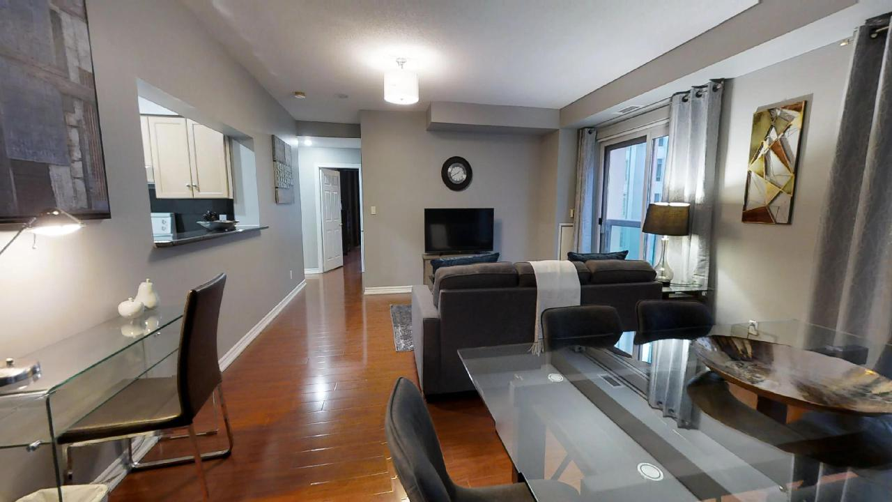 alternative view of a living room in Qwest's two bedroom furnished apartment in TOronto, near osgoode station