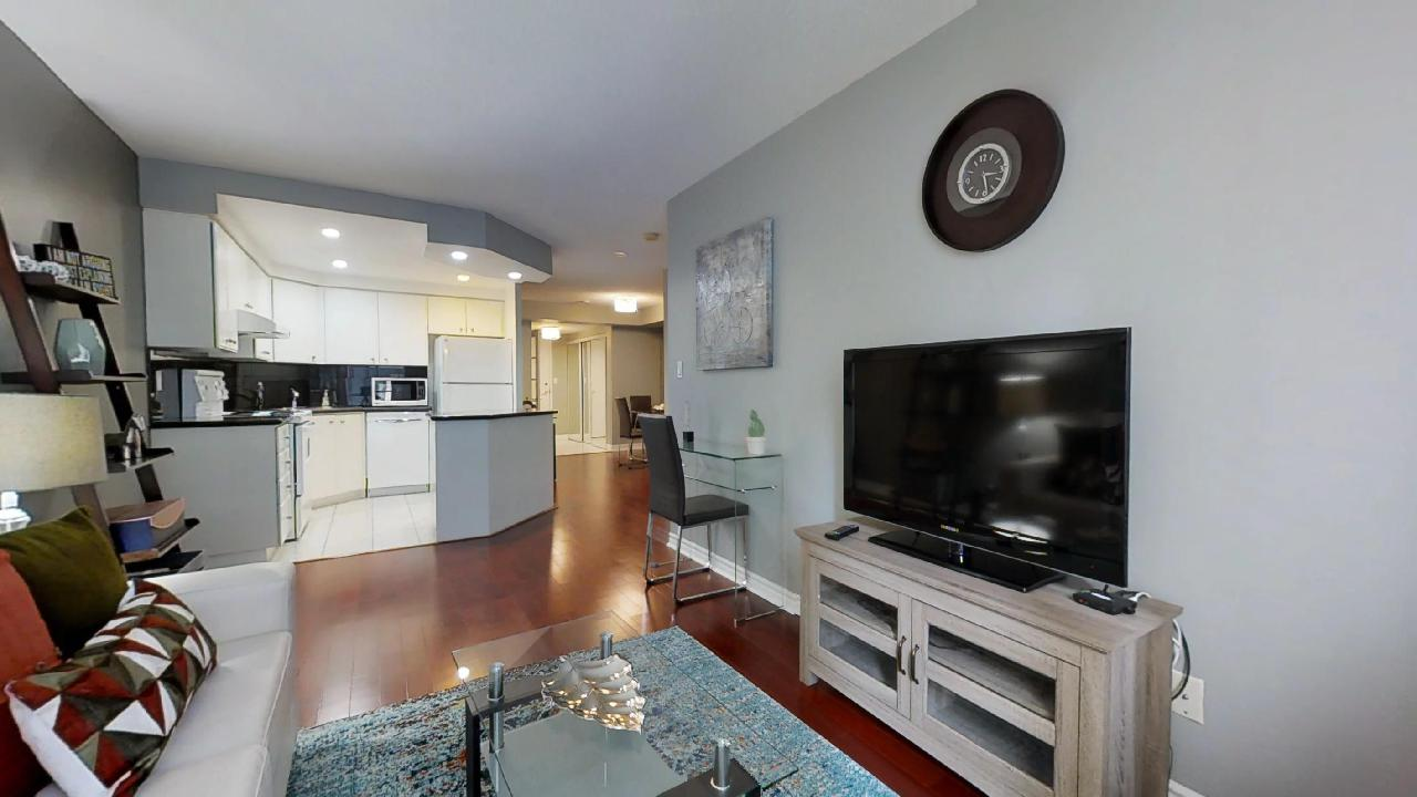 television and kitchen in a QWest furnished apartment