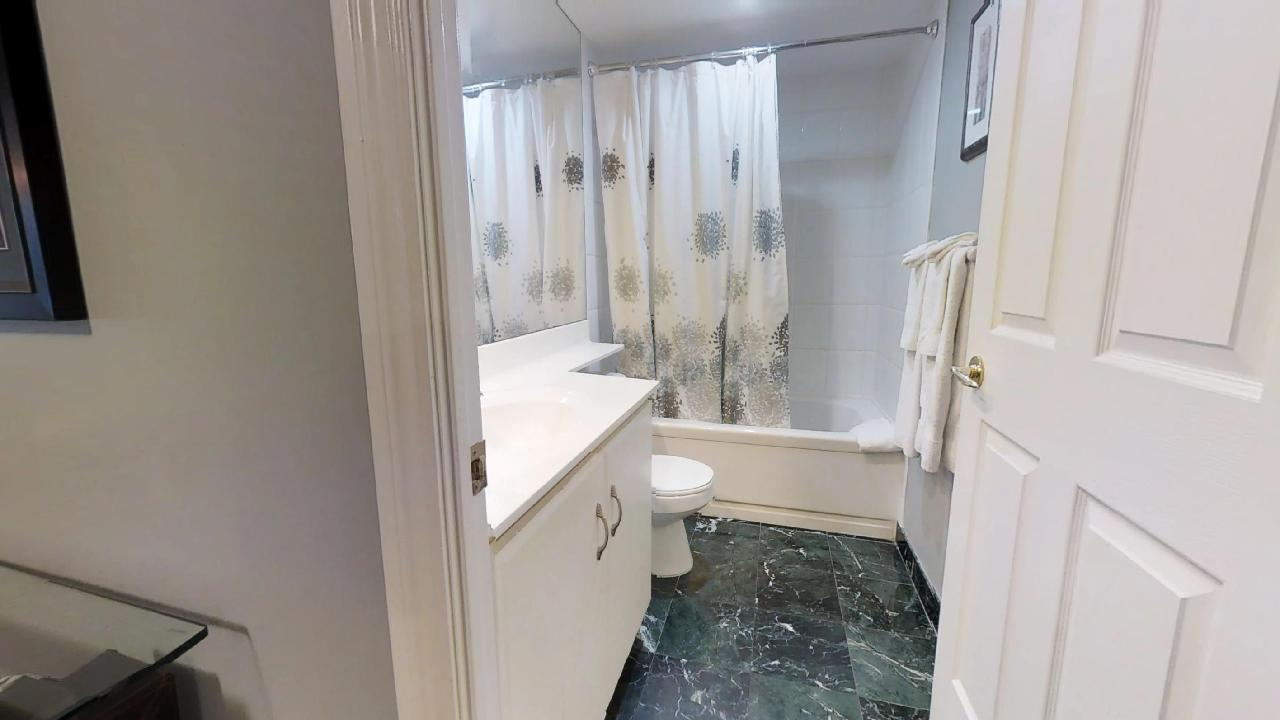 bathroom in a furnished apartment near osgoode station