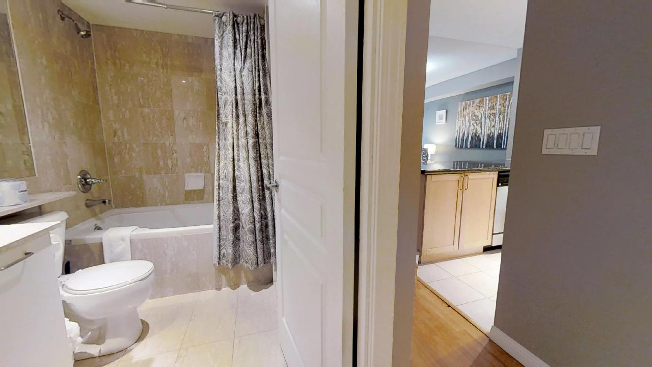 first bathroom in a toronto furnished apartment located at University Plaza