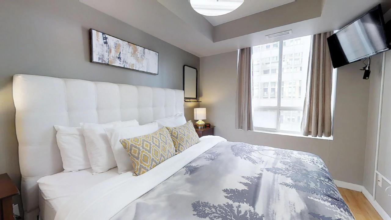 The master bedroom in a toronto furnished apartment, near St. Andrews Station
