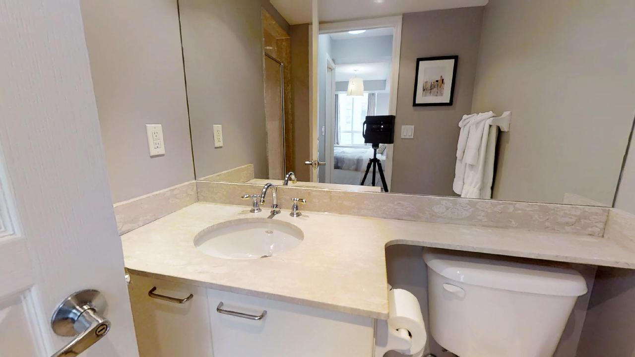 a bathroom in a fully furnished apartment for rent in downtown Toronto at University Plaza