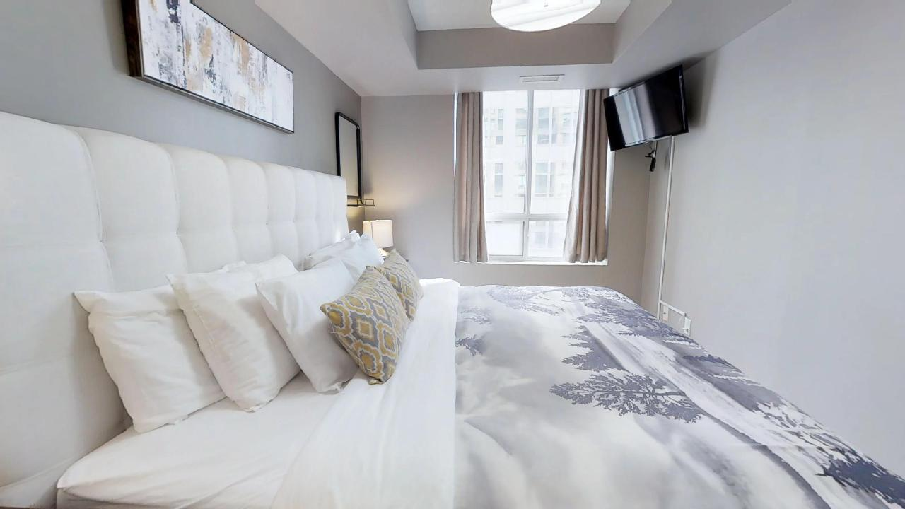 Master Bedroom in a Toronto furnished apartment at Richmond and Simcoe