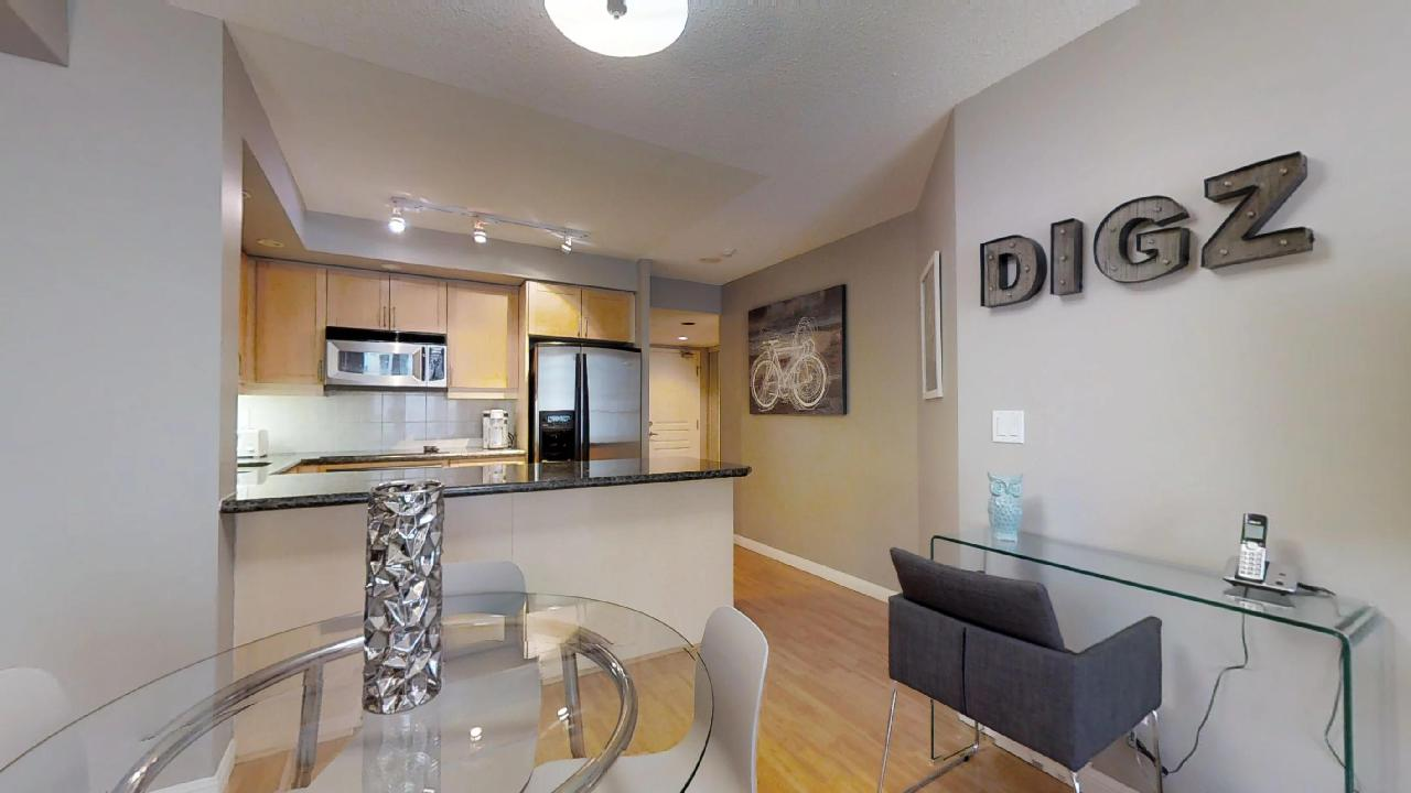The living room and kitchen of a Toronto furnished apartment at Simcoe and Richmond