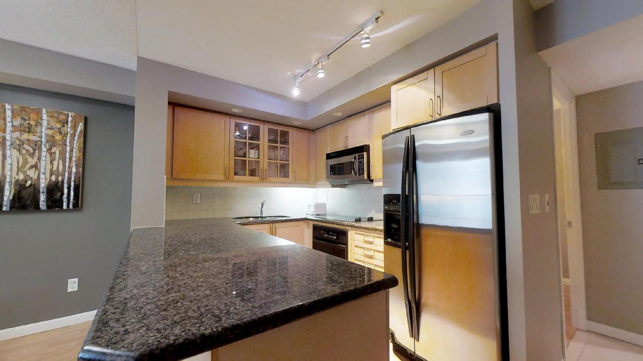 Fully furnished kitchen in a Toronto furnished condo, located near University Plaza