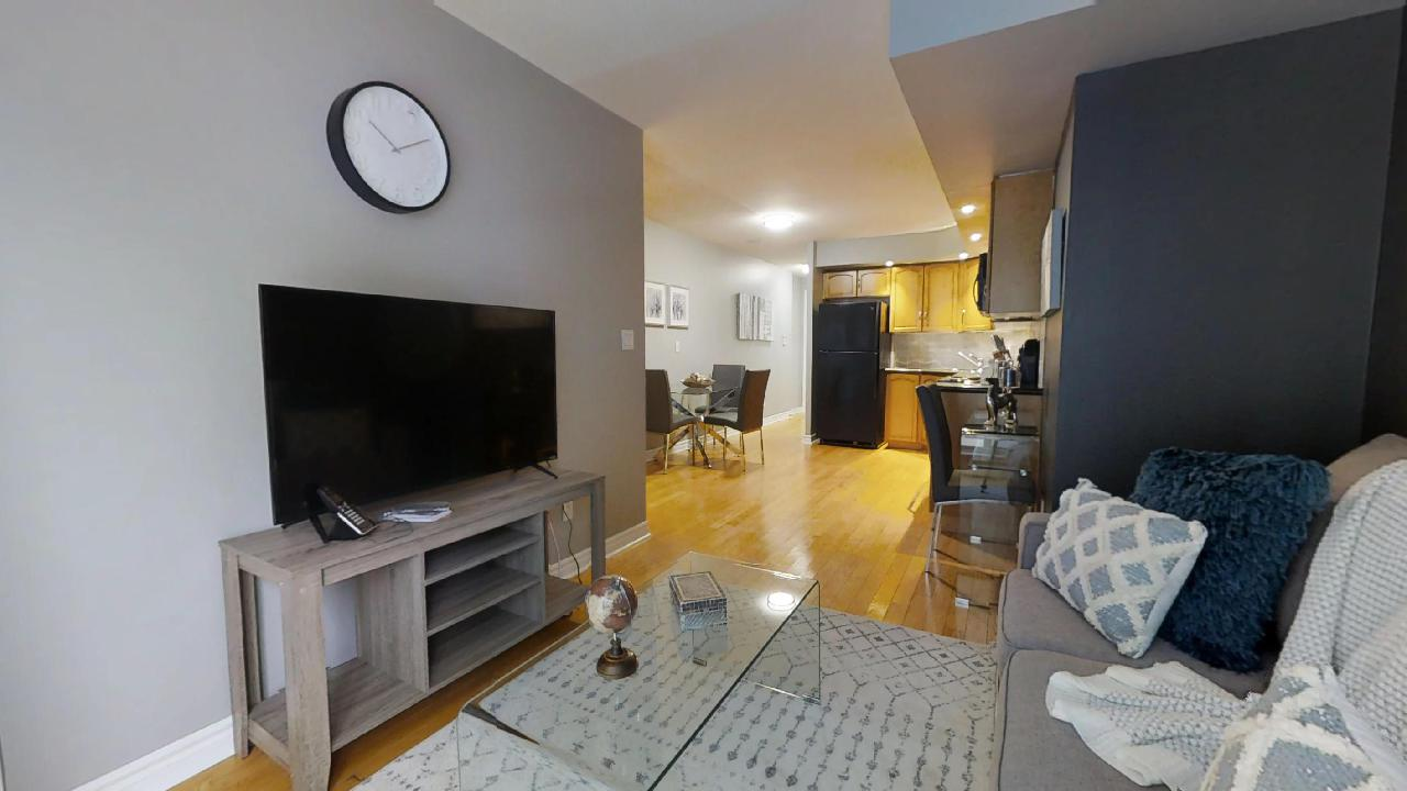living room and kitchen view in Icon furnished condo in toronto