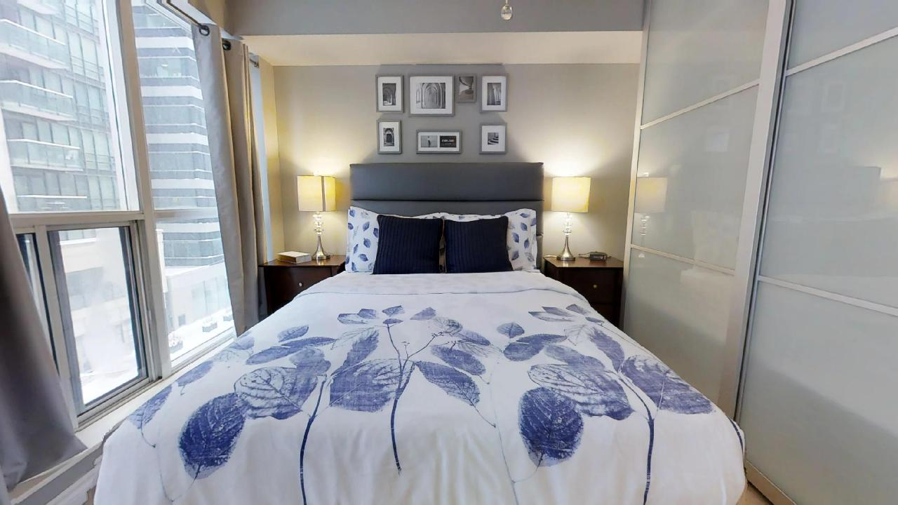 blue bed, featured in a toronto furnished apartment