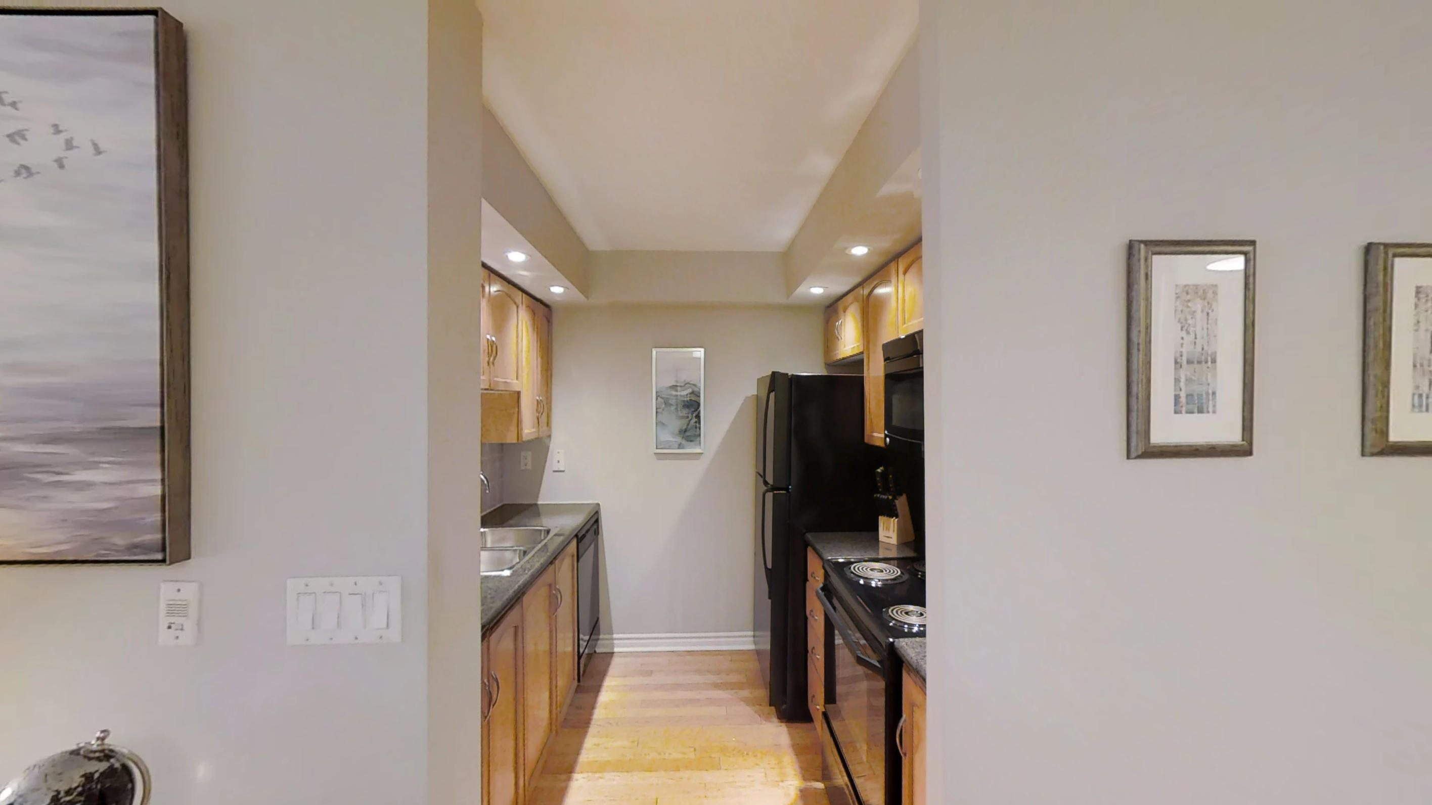 a view of the furnished kitchen of a toronto condo near Wellingont and Blue Jays Way