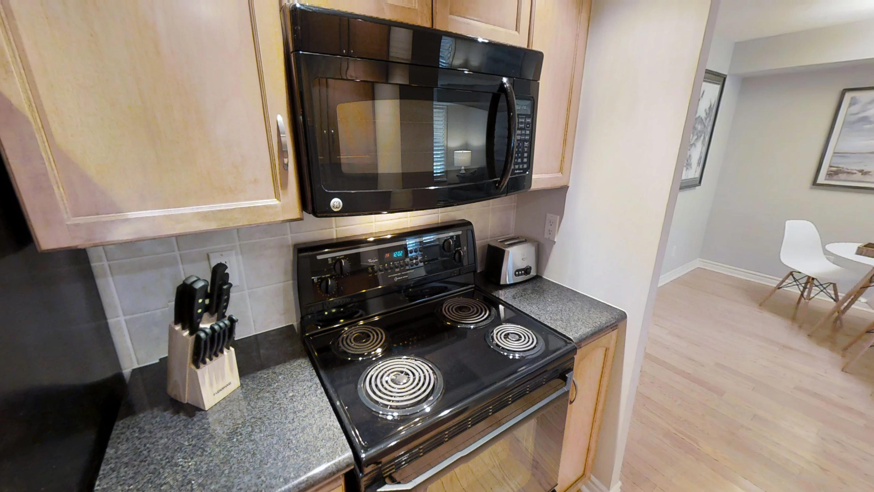 the oven and microwave in a furnished apartment in downtown Toronto, near Wellington and John