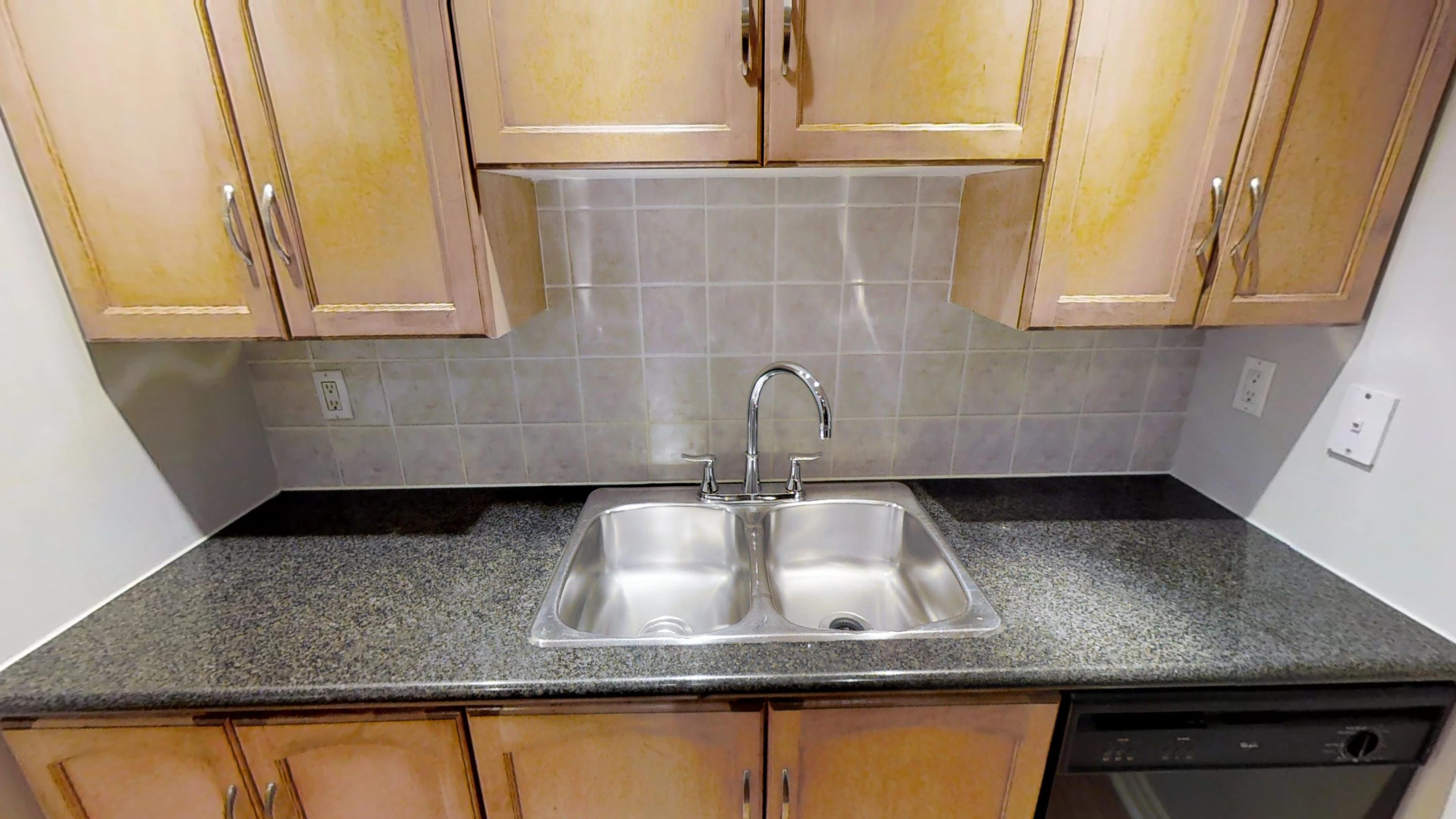 the kitchen sink of a furnished apartment near Toronto's entertainment district