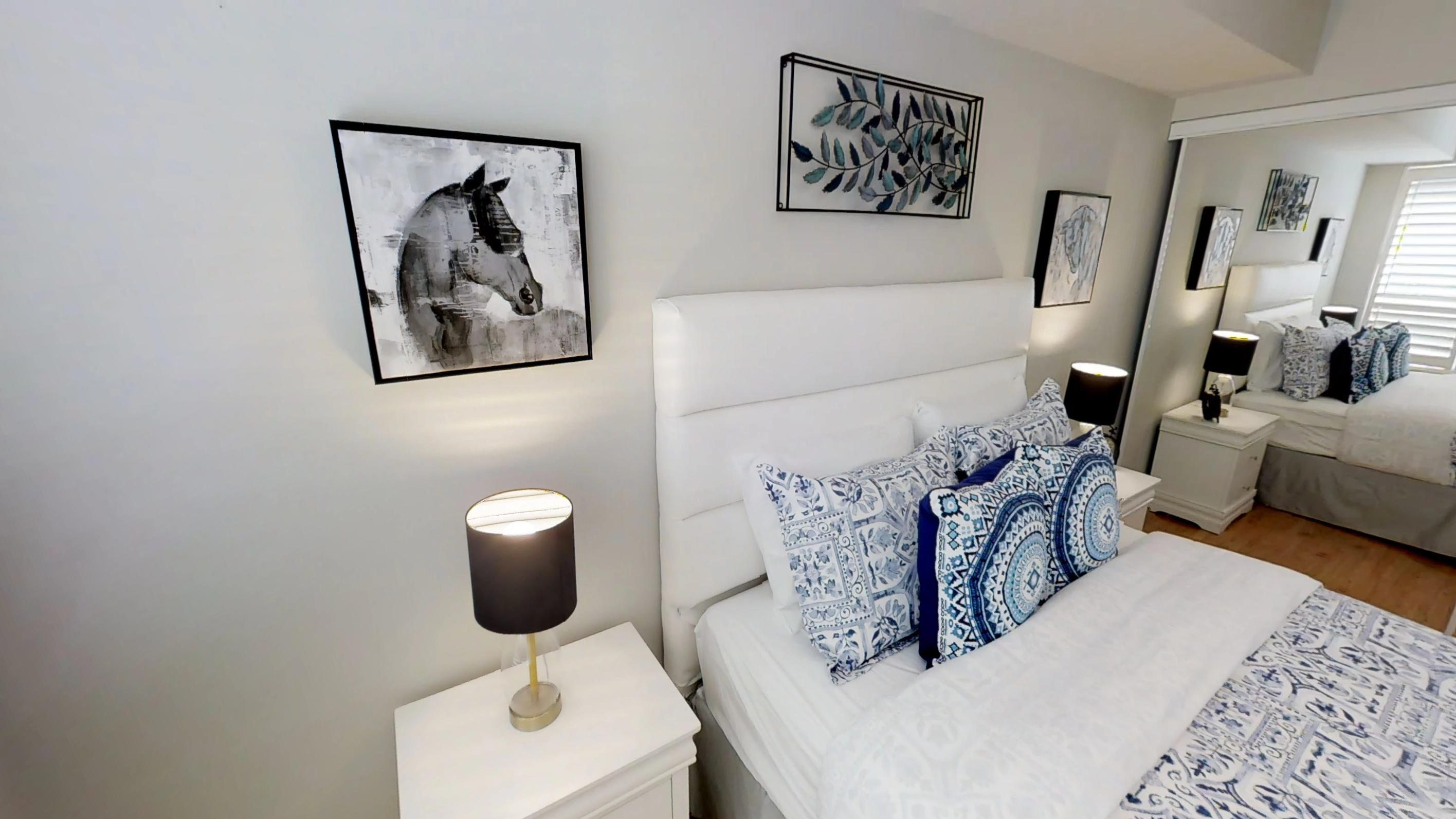 Horse art and bed in master bedroom in a fully furnished serviced apartment in downtown Toronto, near the Roger's Centre