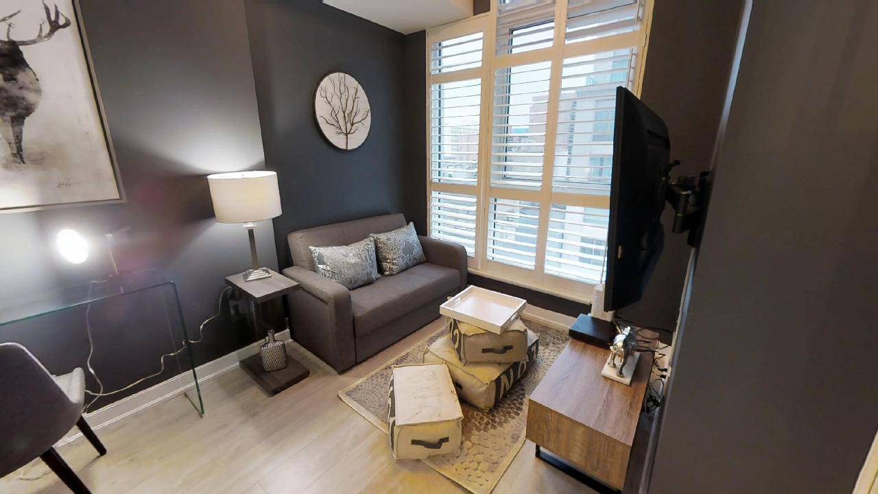 living room of toronto furnished apartment near osgoode