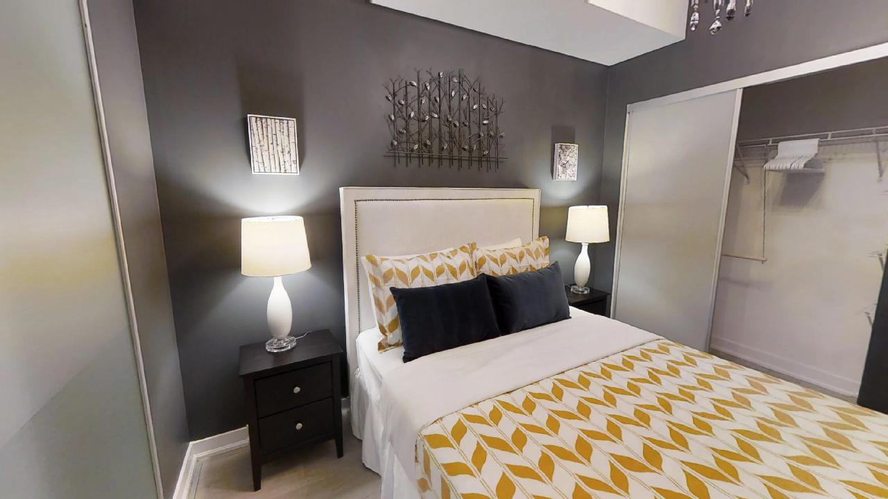bed and nightstands in a furnished apartment in toronto, ontario