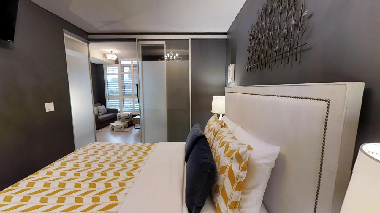 a great bedroom and living area in a downtown fully furnisedh condominium apartment