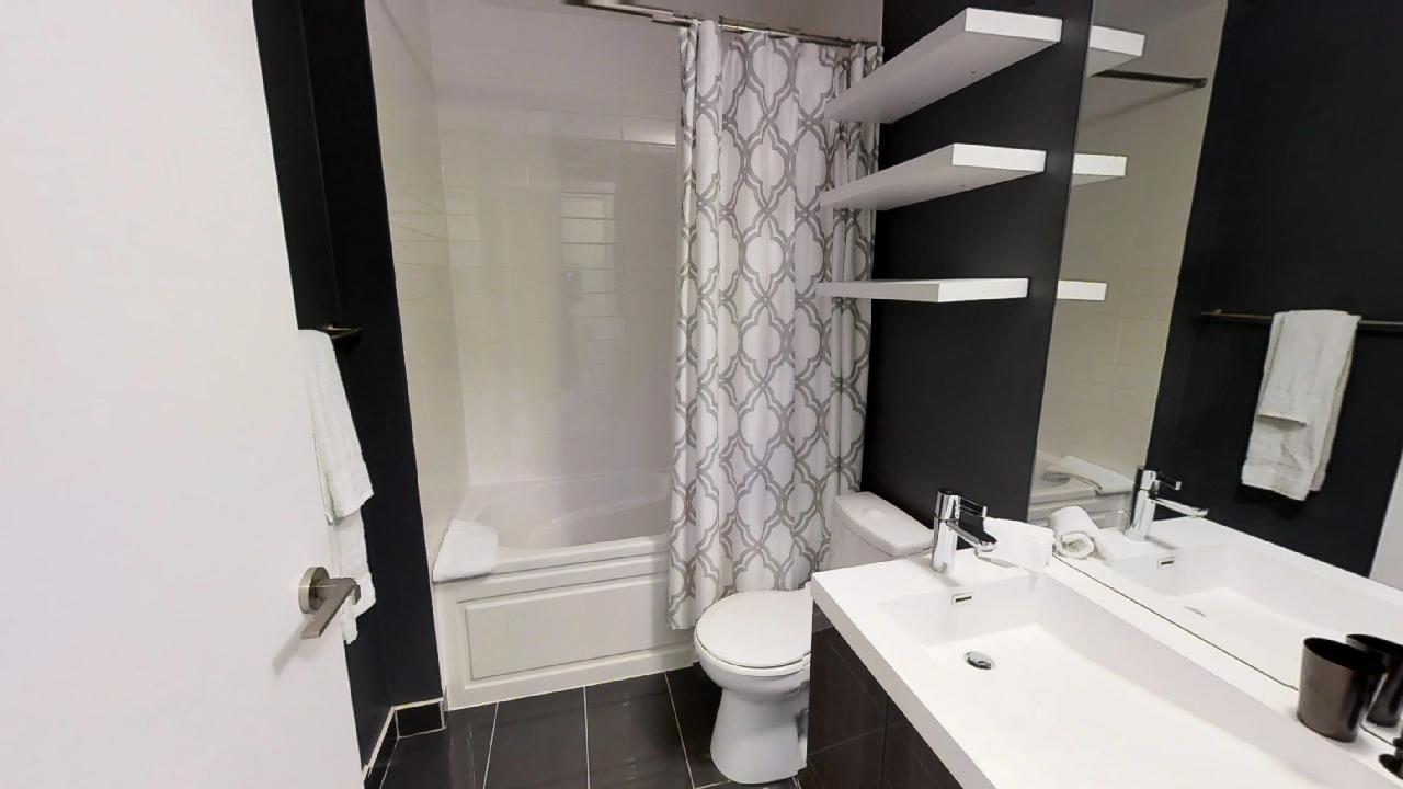 a fully furnished bathroom, by Sky View Suites