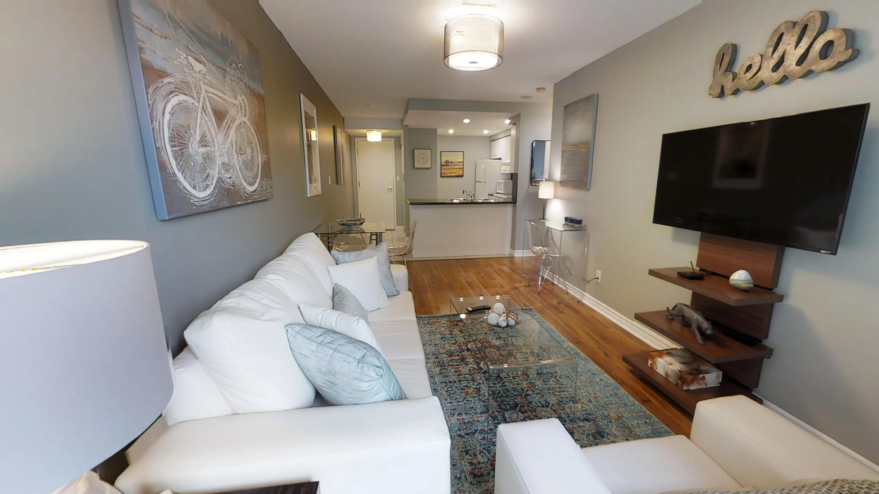 Qwest furnished condo toronto living room and kitchen