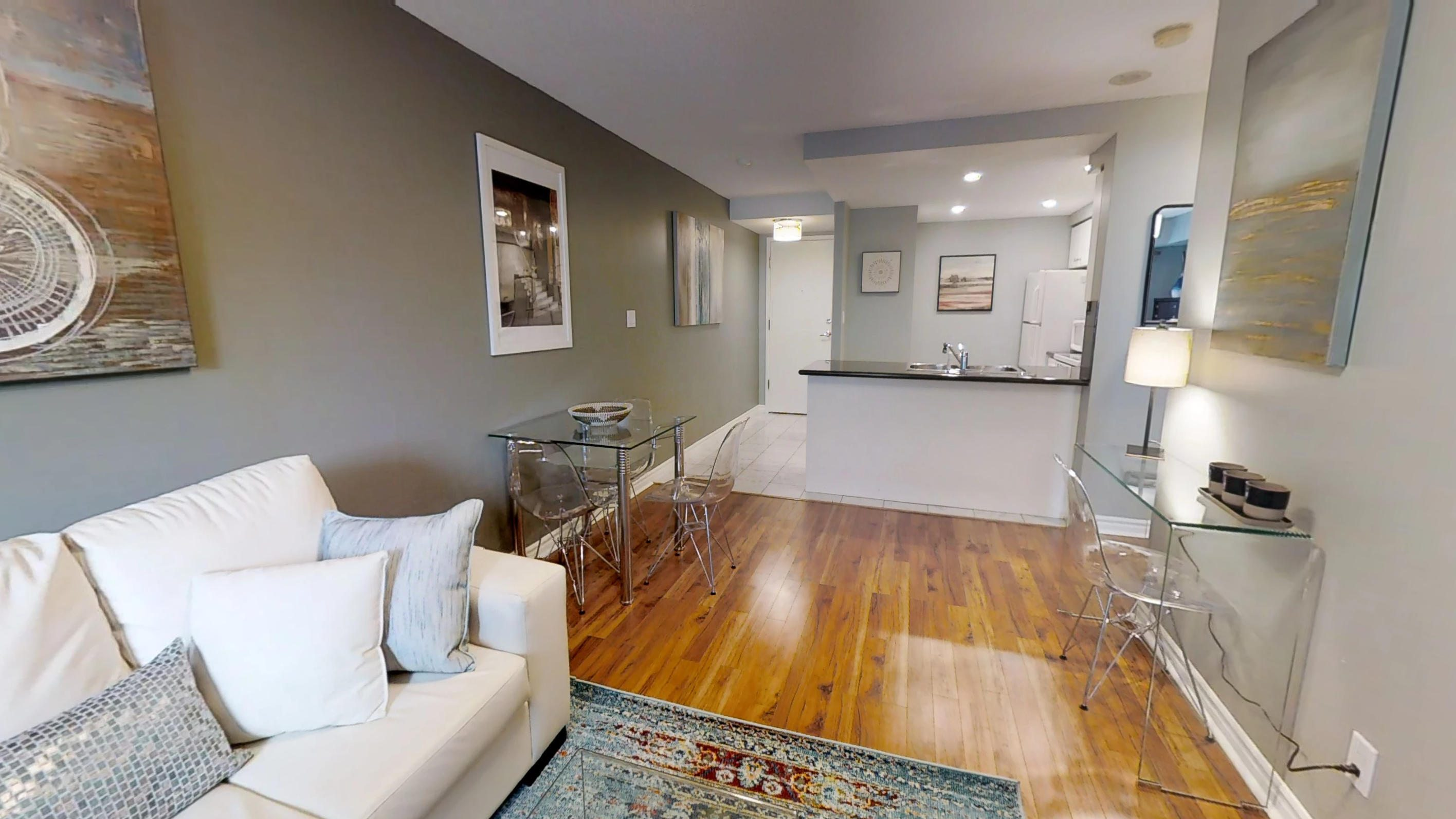 view of the kitchen and hardwood floors in a furnished apartment in downtown toronto at 168 simcoe street