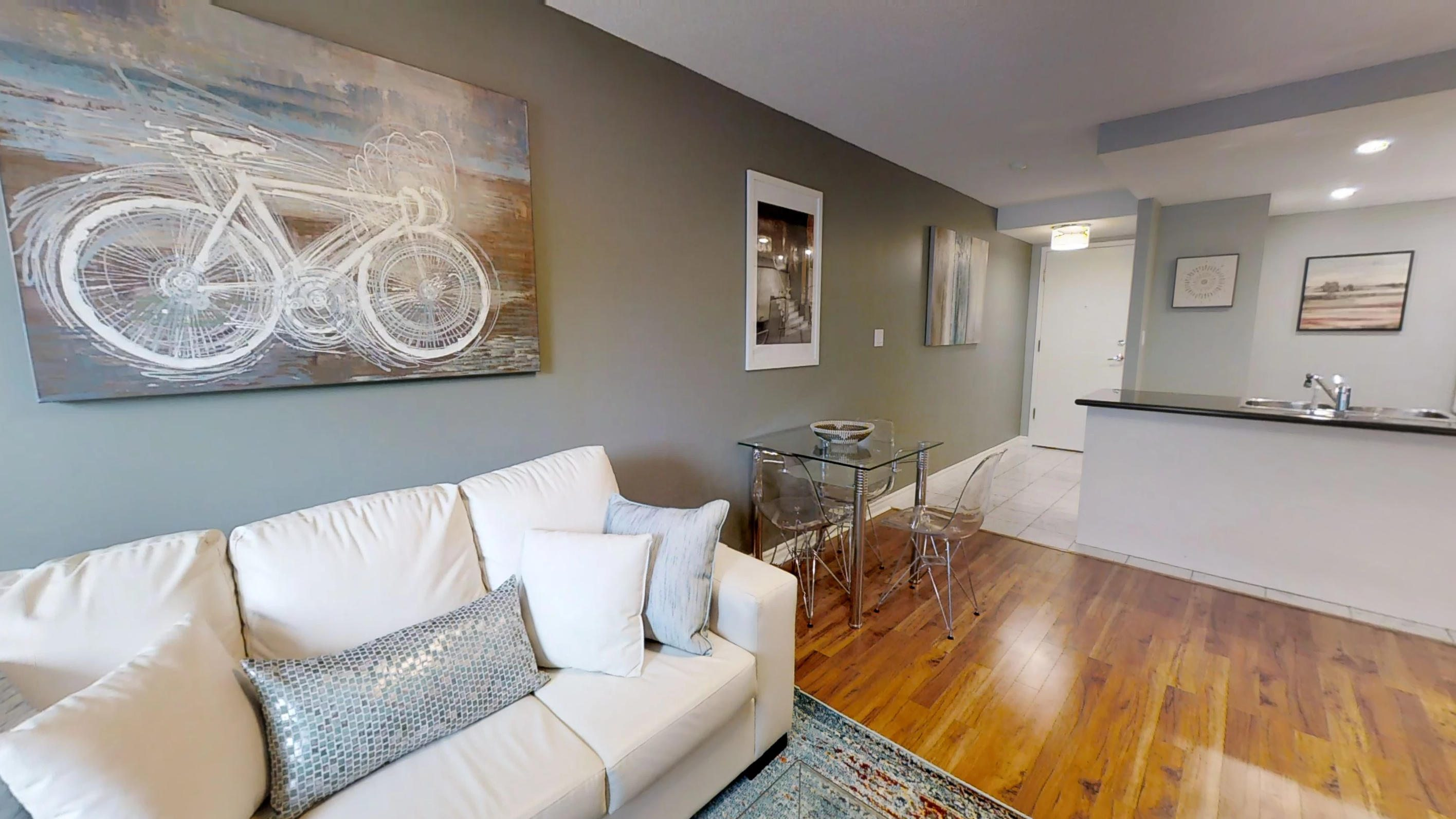 area rug over the hardwood floor in a toronto furnished apartment near simcoe and queen