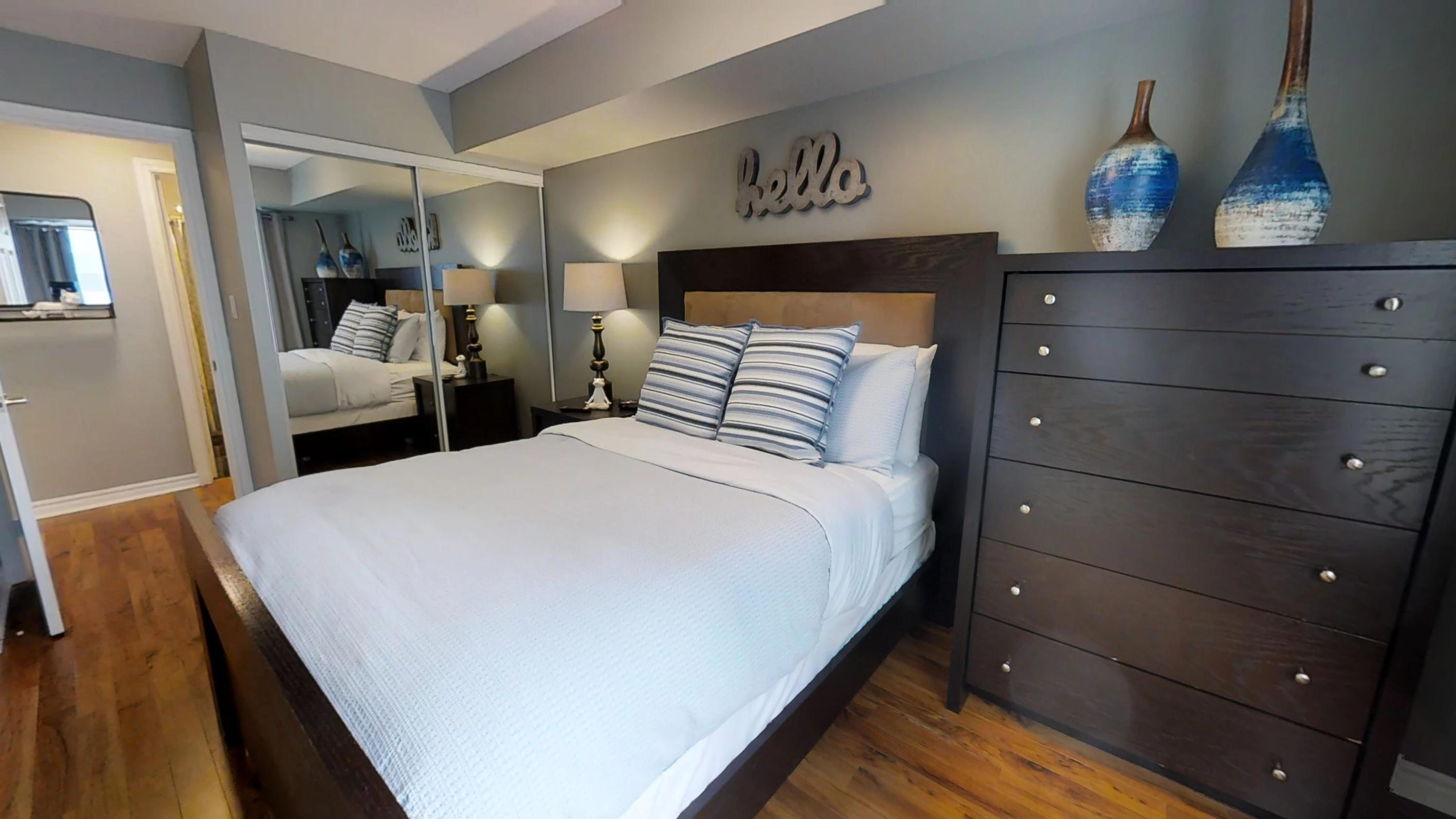 furnished bedroom in a corporate stay apartment located near Bay street in downtown Toronto
