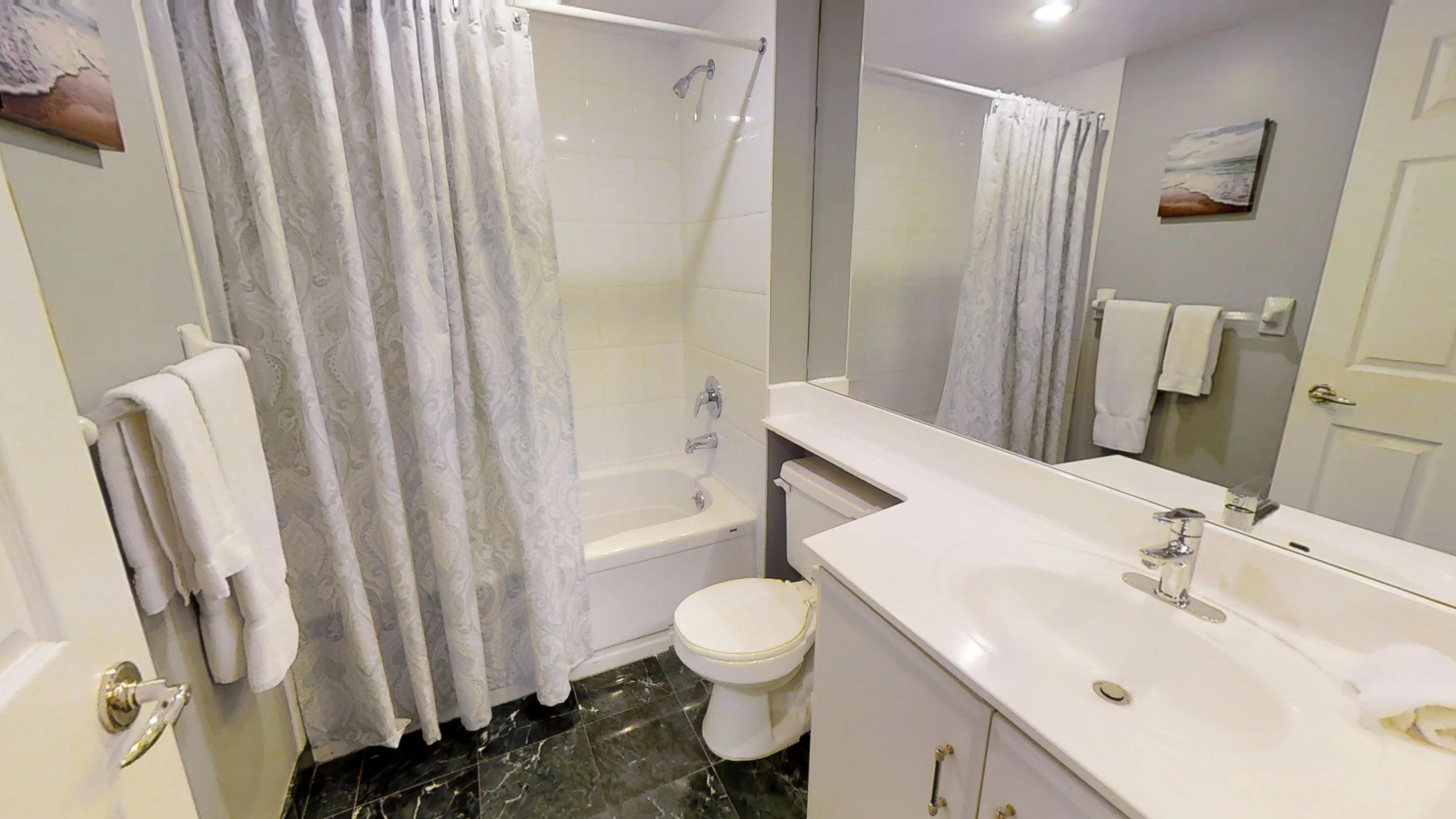 Furnished bathroom in a one bedroom furnished apartment in Qwest